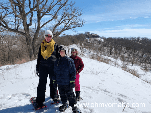 Kim and her family snowshoeing through the winter wonderland of Hitchcock Nature Center. Image credit Kim Reiner.