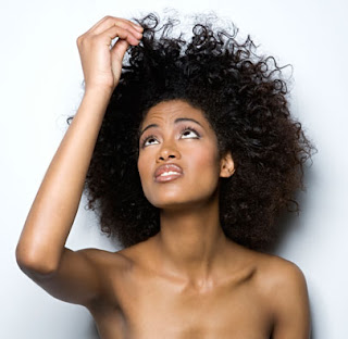 Woman Looking at her Natural Hair