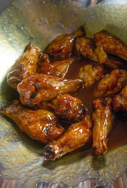 wings in a metal bowl with bbq sauce