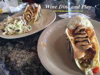 Grouper tacos under the hand held portion of the menu at the Ozona Blue Grill in Palm Harbor, Florida