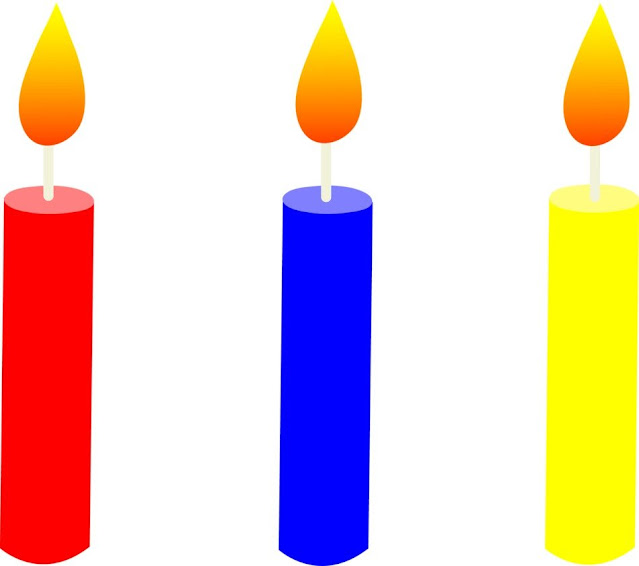 Picture of three candles of different colors