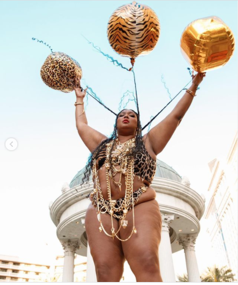 Lizzo shows off her curves in a tiger-print bikini as she celebrate her 33rd birthday (photos)