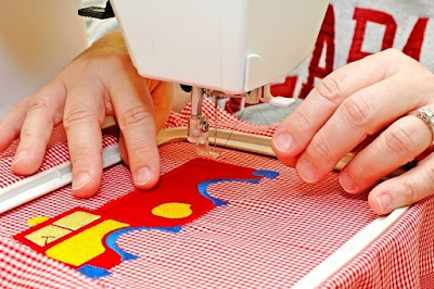 Woman Stitching in a Embroidery Machine