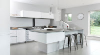 Modern timeless white contemporary kitchen style ideas with cool gray bar stools and gray countertops also with lovely pendant lamps
