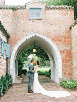 bride and groom standing under arch at casa feliz