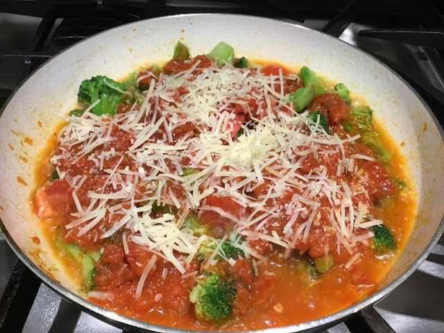 broccoli and Parmesan cheese in a skillet