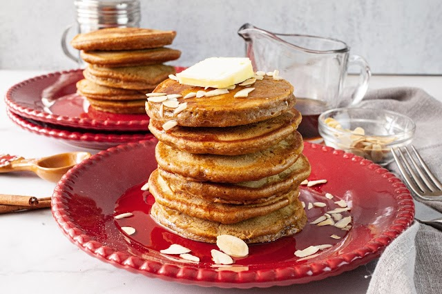 Pancakes on two red plates