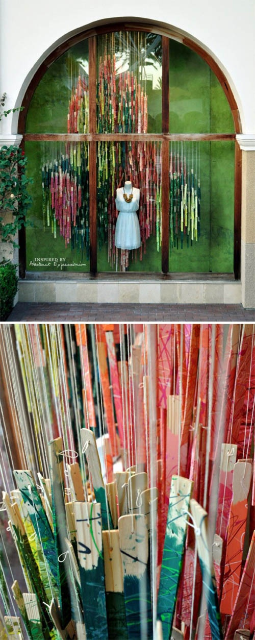 This elaborate paint stick are is colorful and unexpected in the shopping window.
