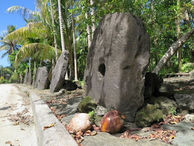Stone money and coconuts on Yap Island, Micronesia.