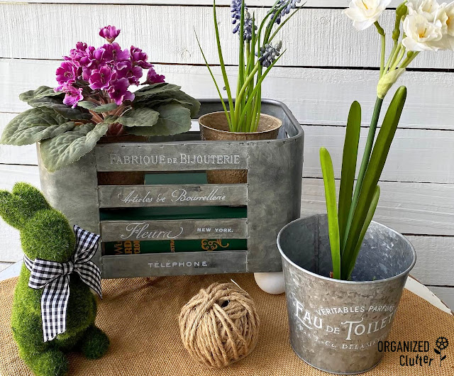 Photo of galvanized containers with faux spring florals