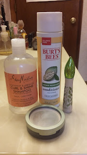 Shea Moisture shampoo, Burt's Bees conditioner, Physician's Formula Organic mascara, Carmindy powder