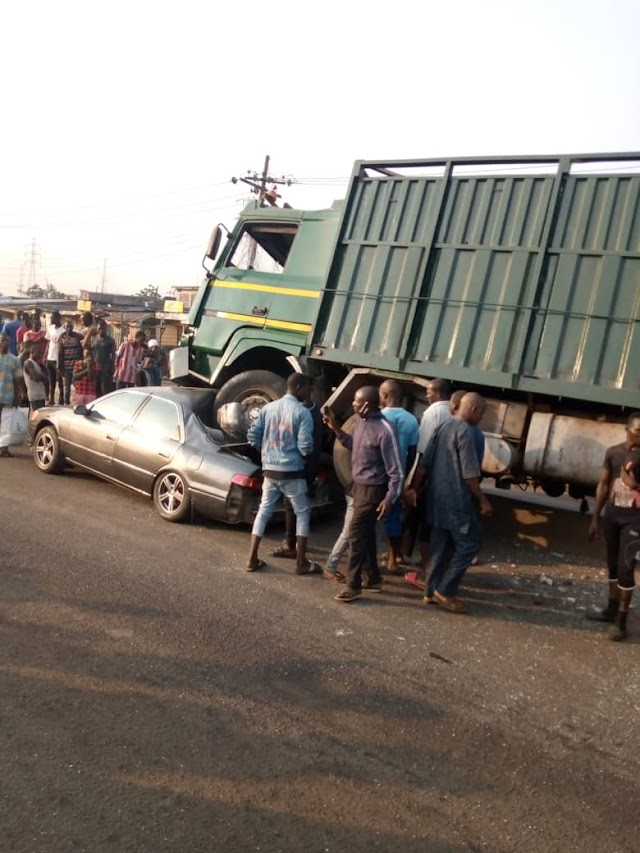 Truck Crushed A Toyota Car In Front of Mandela Garage, Mile 12, Lagos. PHOTOS