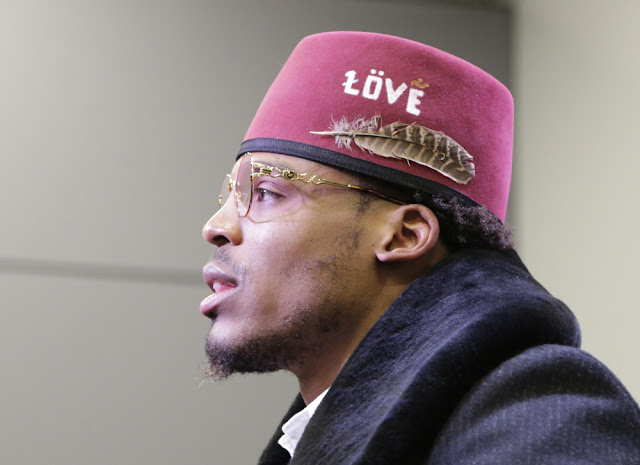 cam newton with a moorish american fez and feather