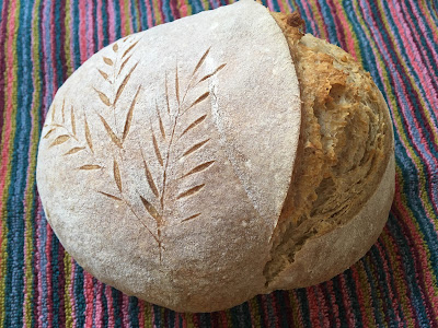 A round loaf with a wheat stalk scoring pattern