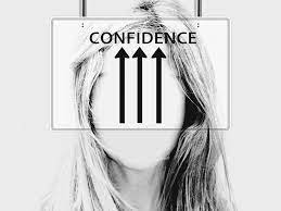 """on the forehead of a woman written """"Confidence"""""""