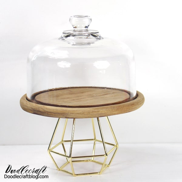 Geometric Cake Stand DIY with Tealight Holder Upcycle a few items to make a geometric cakestand, perfect for parties and home decor. This fun DIY just needs a glass cloche and a tea light holder.   Perfect for holiday entertaining and it just takes a few minutes to assemble.