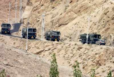 LAC soldiers their supplies on army envoy