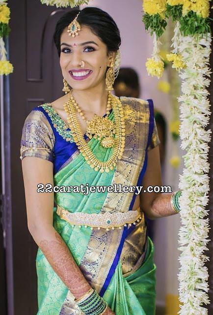 Bride in Kasu Haram Vishnu Pendant