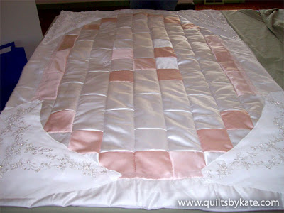 quilt made from a wedding dress