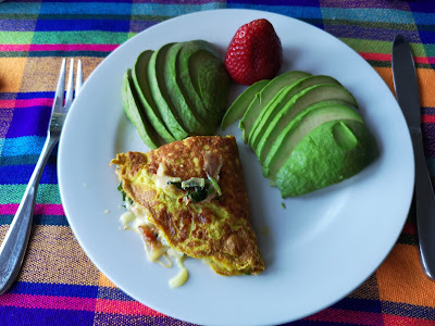 Kale and bacon omelette with avocado