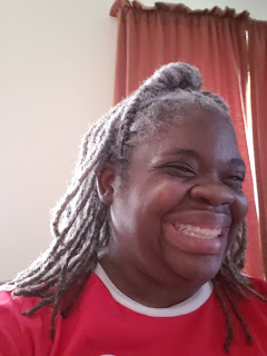 photo of woman with locs smiling