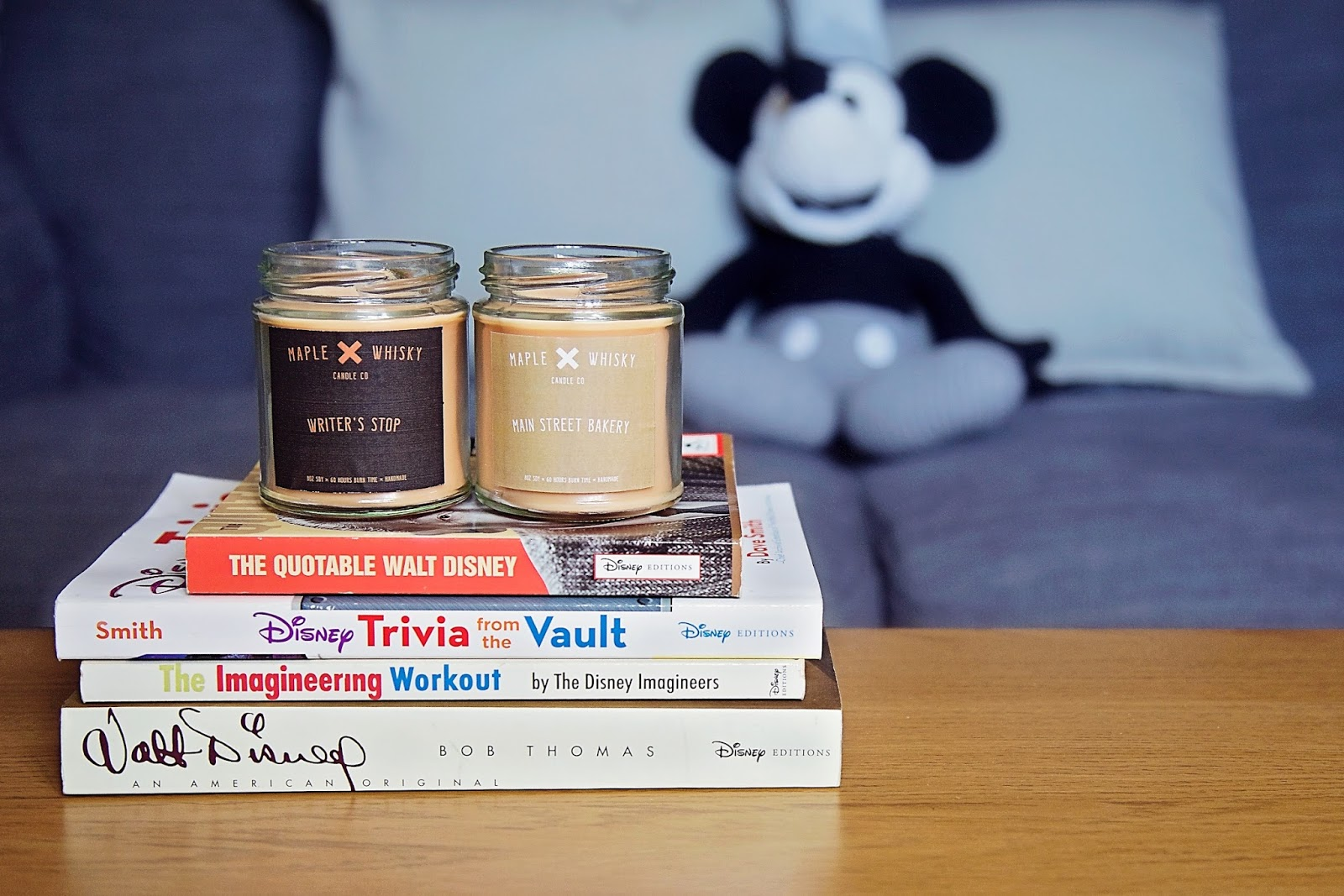 Maple and Whisky Disney themed Candles on top of Disney Books.