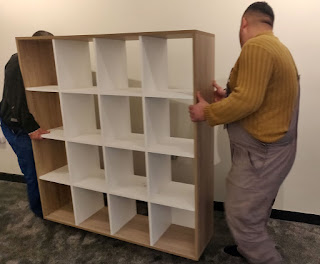 Lifting the first bookcase in