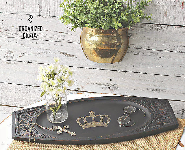 Photo of a black tray with a stenciled crown