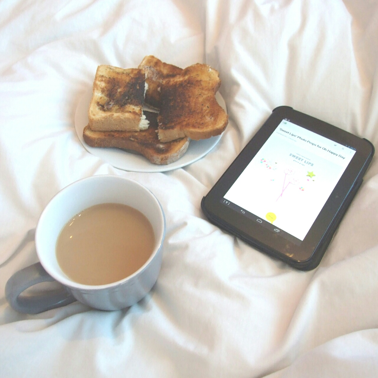Tea, toast and catching up on some blog reading.
