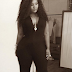 Toolz steps out in black jumpsuit with pluging neckline