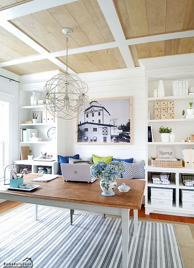 built-ins and a white and blue palette with sphere chandelier