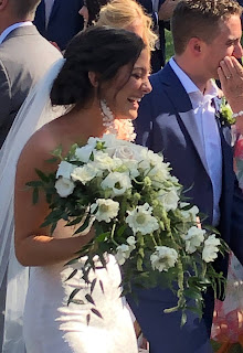 Happy Texas Bride holding her wedding bouquet