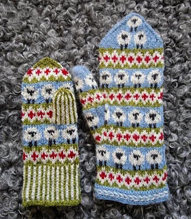 knitted mittens with lativian braid and 3 color stranded knitting