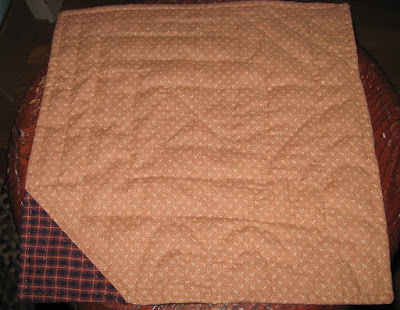 quilted sample of Mountain Mist wool/poly quilt batting after quilt but before washing and drying