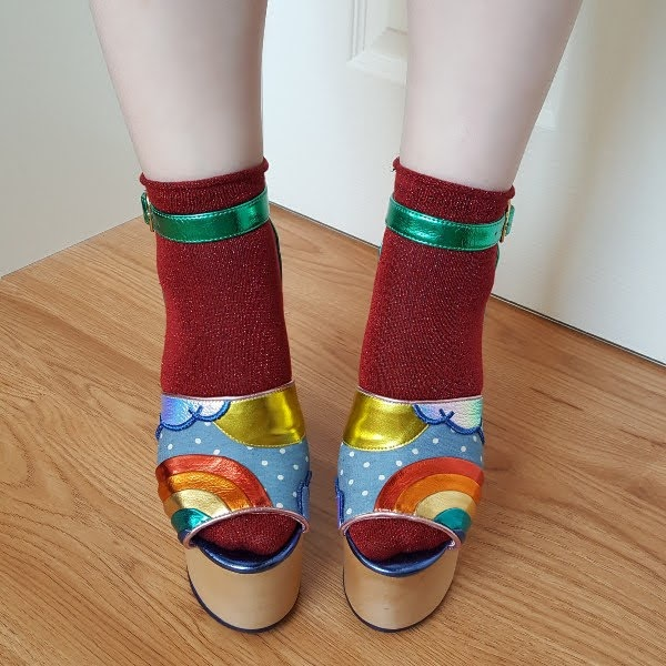 wearing socks and sandals with rainbows on