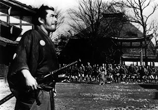 toshiro mifune as ronin sanjuro, arrives at a town/village, yojimbo, directed by akira kurosawa
