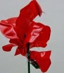 http://handbox.es/como-realizar-una-flor-de-plastico-con-una-botella-pet-reciclada-how-to-make-a-plastic-flower-with-a-recycled-pet-bottle