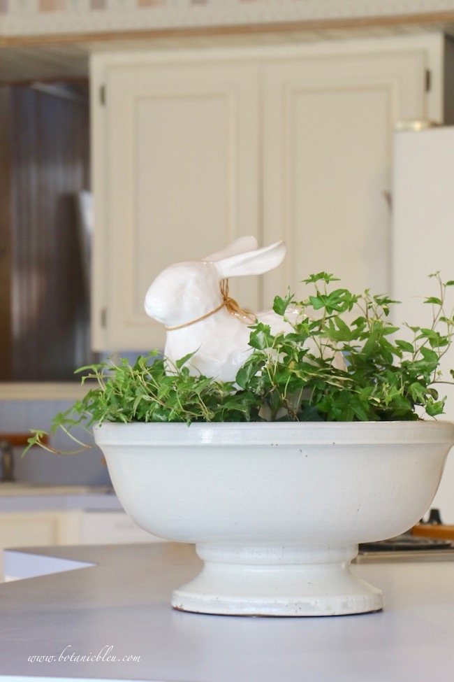 Large white rabbit botanical centerpiece in a French Country kitchen