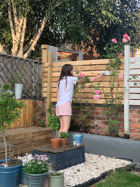 painting a slat fence in johnstone calming stone