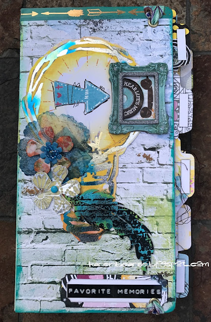 cover of journal light bulb with decofoil, resin flowers & a feather