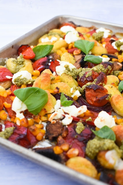 Easy Roasted Vegetable Gnocchi Bake - Step 5 Finishing touches, drizzle dressing over baked veg and gnocchi, then top with basil