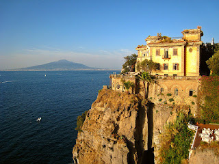 A clifftop hotel in Sant'Agnello with Vesuvius in the  background, across of the Gulf of Naples