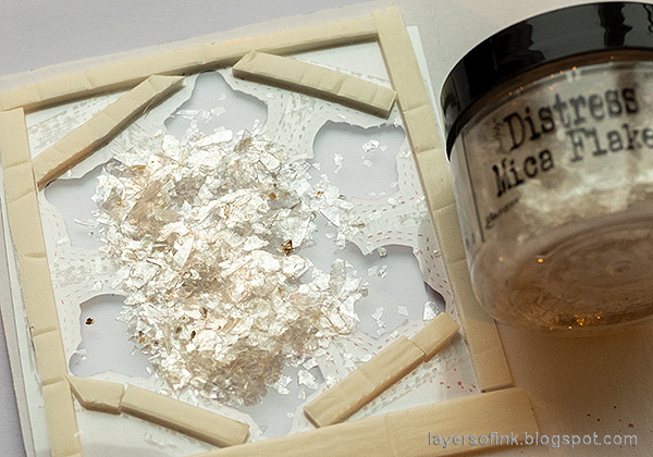 Layers of ink - Snowflake Shaker Card Tutorial by Anna-Karin Evaldsson.Fill the shaker with mica flakes.