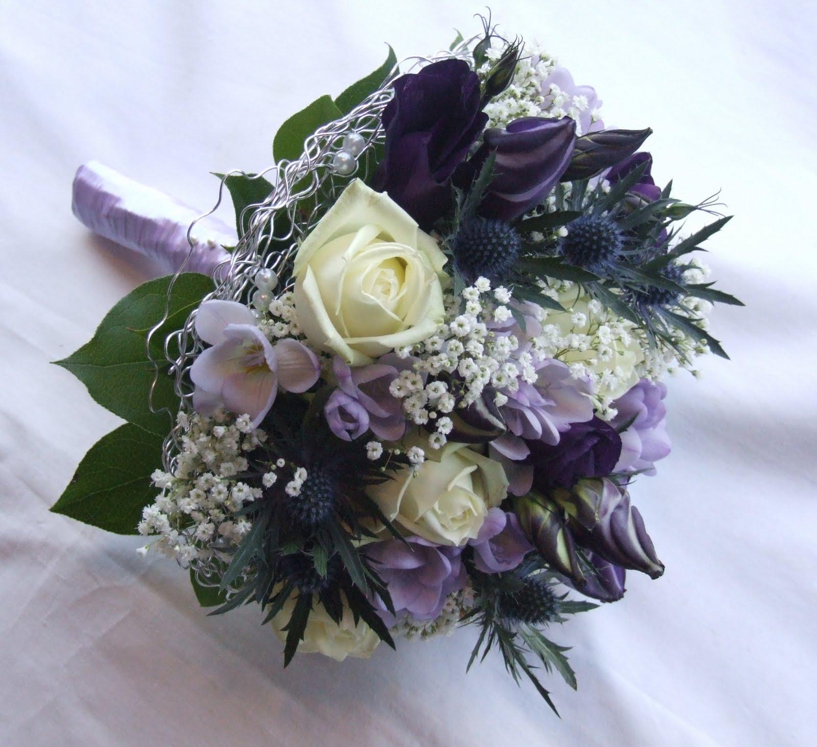 RJ's Florist: Purple, lilac and ivory wedding flowers