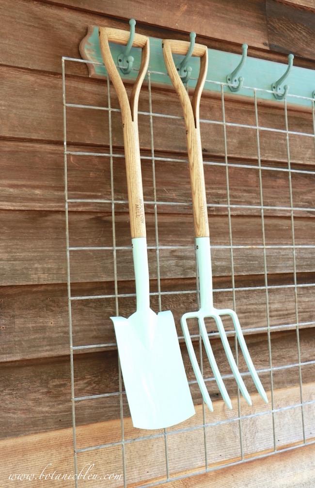 pale-blue-garden-shovel-and-fork-for-potting-bench-area