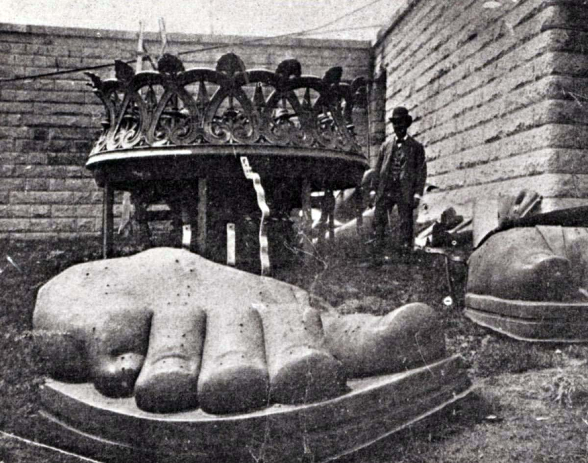 The Statue of Liberty's limbs and crown arrived piecemeal before they were constructed together into Lady Liberty. They're seen being uncrated here on Liberty Island in 1885.