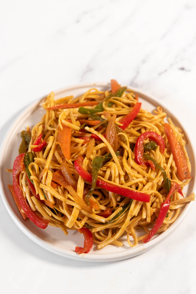 Photo of a plate of noodles with vegetables