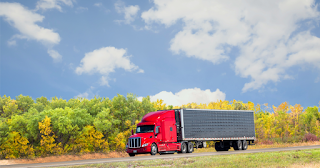 Trucking down the highway, up to date on truck taxs like IFTA fuel tax and Form 941.