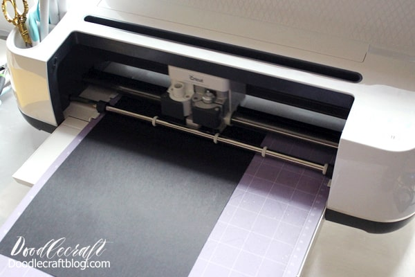 Use the cricut maker to cut the cardstock to make a cake topper.