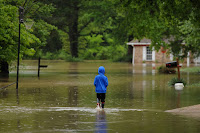 A flooded neighborhood in Arnold, Missouri on May 4, 2017. Heavy downpours from slow-moving storms over the past week sent rivers over their banks, flooding towns and shutting down roads and highways in several states. (Credit: Michael B. Thomas/Getty Images) Click to Enlarge.